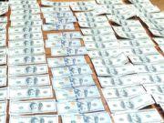 У Києві зловили камерунців, які штампували підроблені долари