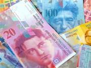 """ЦБ Швейцарії зберіг """"стелю"""" курсу франка до євро, підвищив прогноз інфляції на 2014р."""