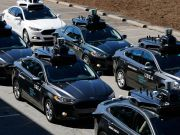 На рынке робомобилей соперничают модели «айфона» и «андроида»