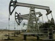Цены на нефть колеблются на фоне укрепления доллара
