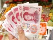 Китай понизил курс юаня до минимума с мая 2011 года