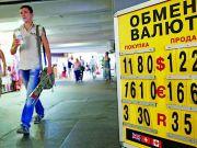 Політика і економіка штовхають курс долара вгору