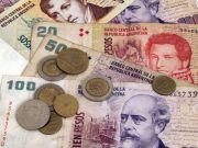 Аргентинский песо рухнул на 38% после отмены валютного контроля